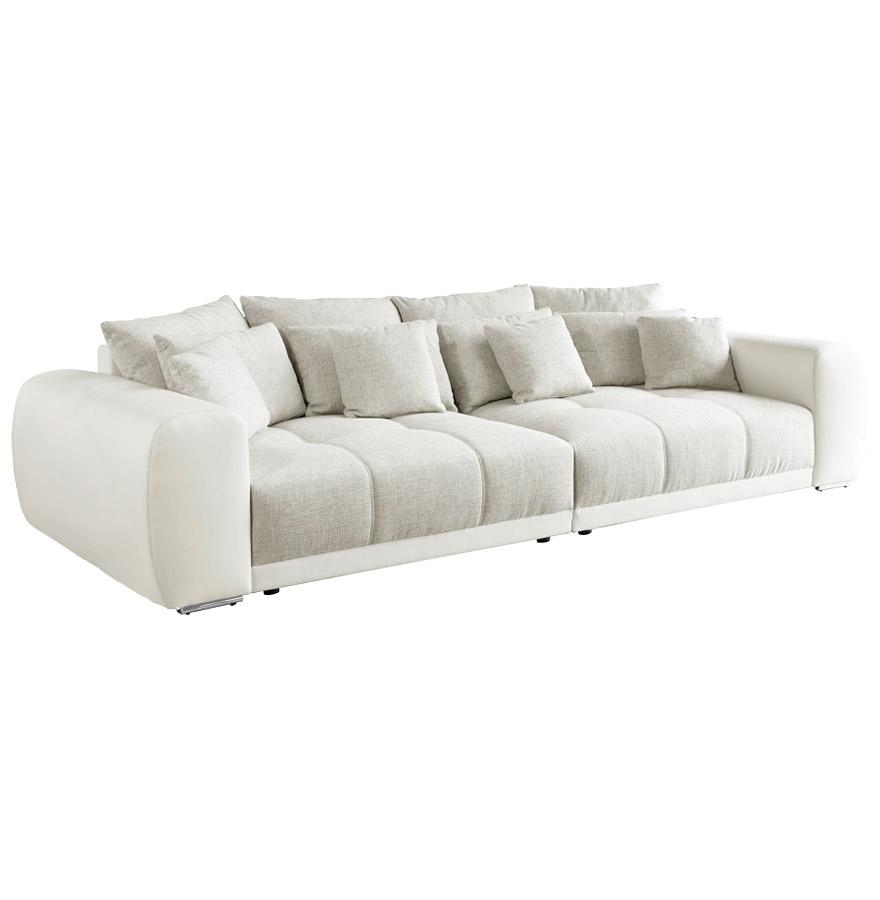 Grand canapé 4 places, recouvrement en tissu et similicuir.