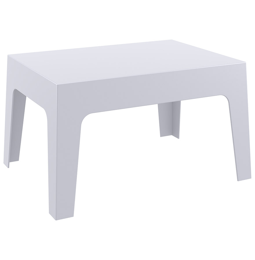 Table basse en matière plastique pour usage extérieur et intérieur.