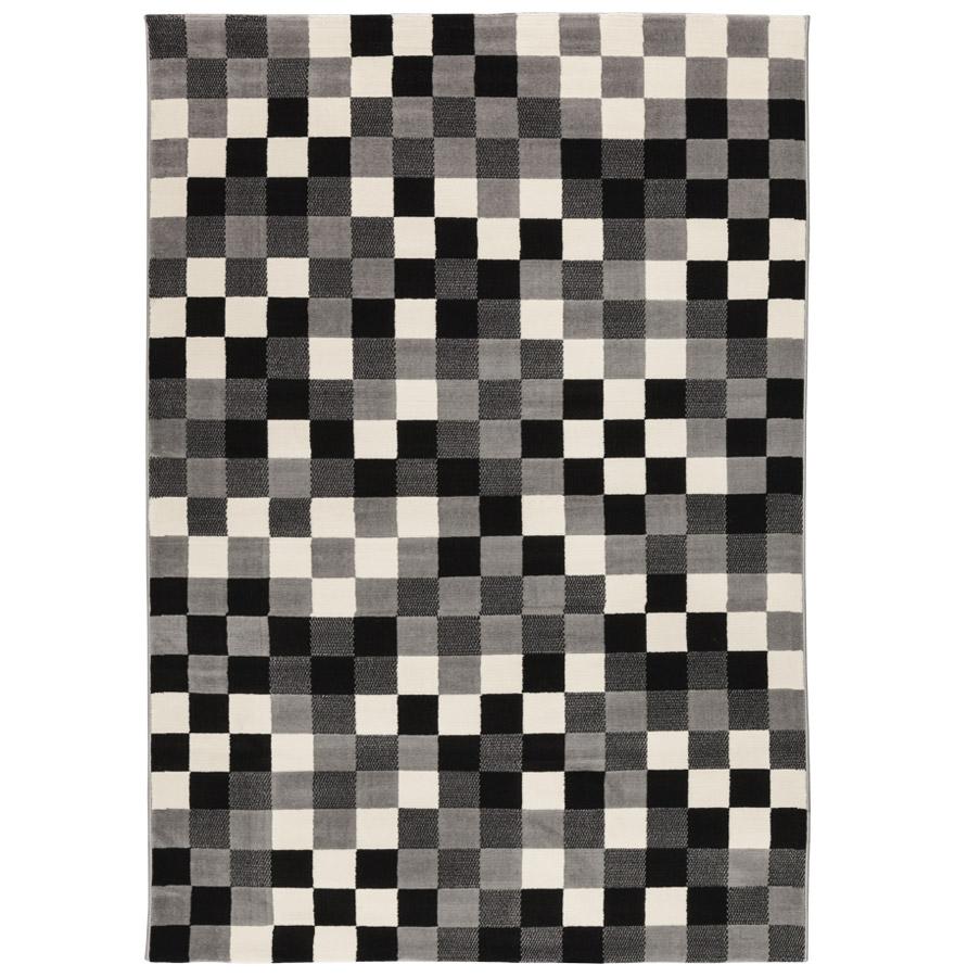 Effet doptique étonnant pour ce tapis design aux couleurs grises.